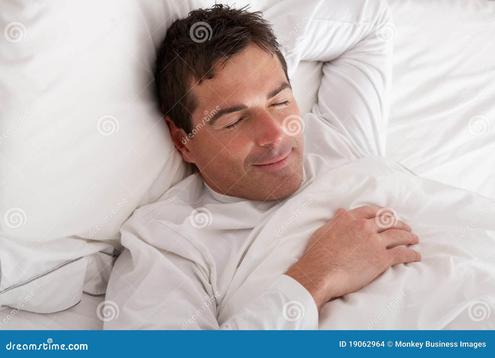 Monkey Sleeping On A Bed