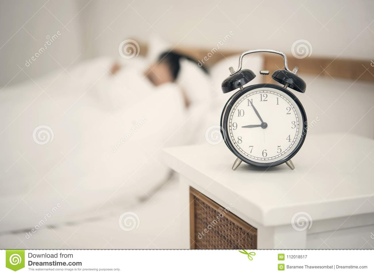 Man Sleeping On Bed In Bedroom And Alarm Clock. Stock Image ...