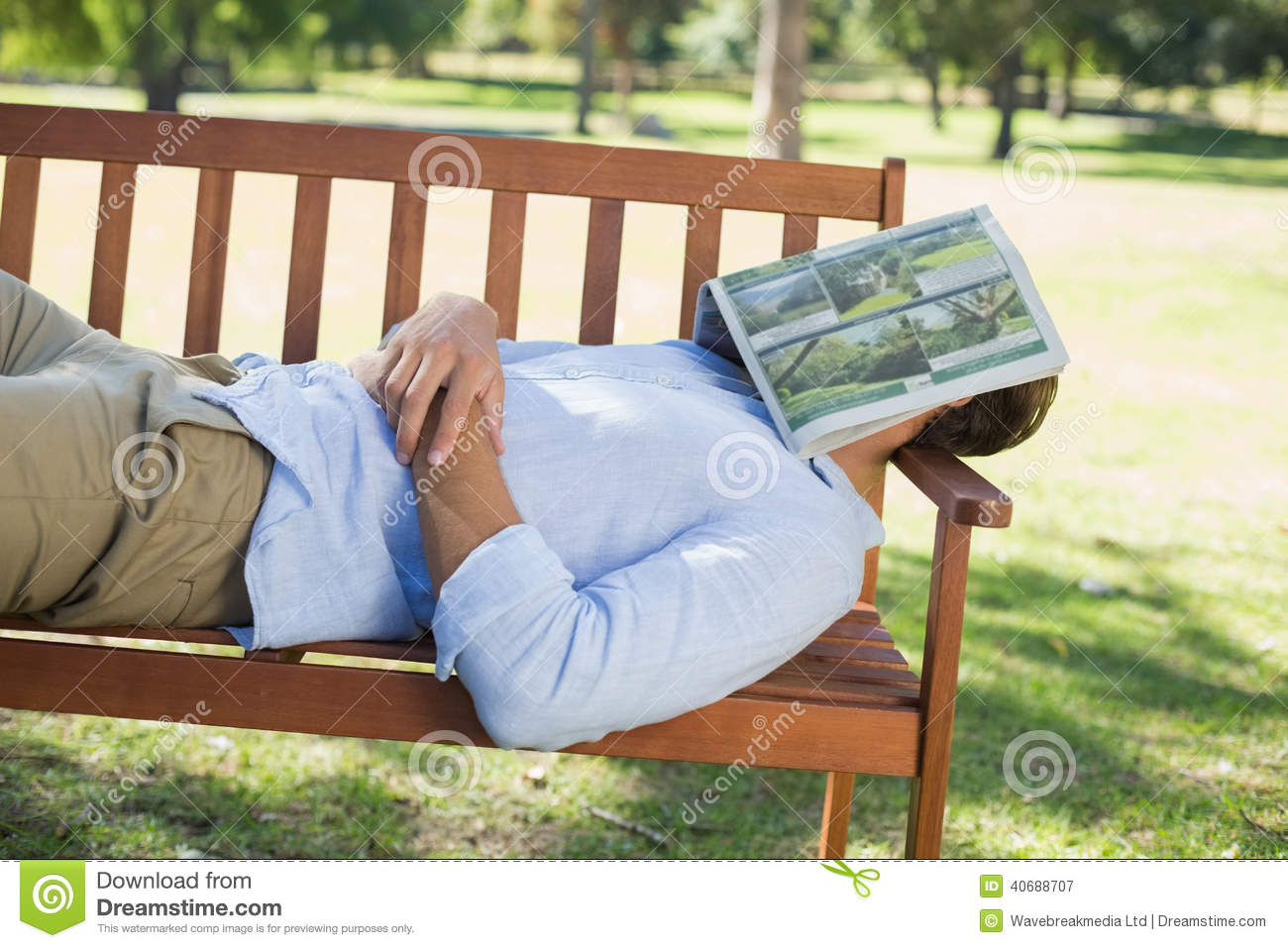 Man Sleeping On Park Bench With Newspaper Over Face Stock Photo ...