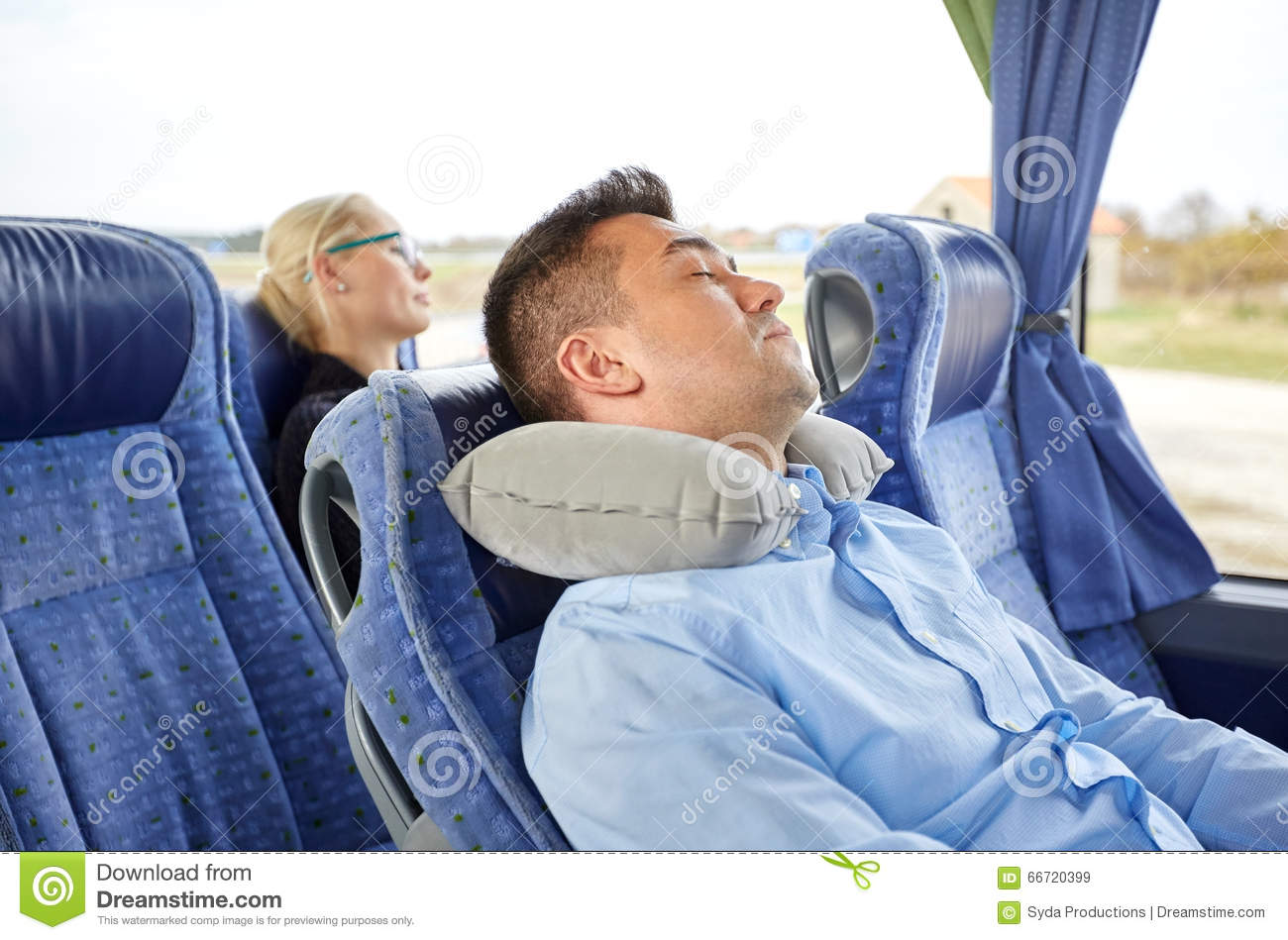 Man Sleeping In Travel Bus With Cervical Pillow Royalty