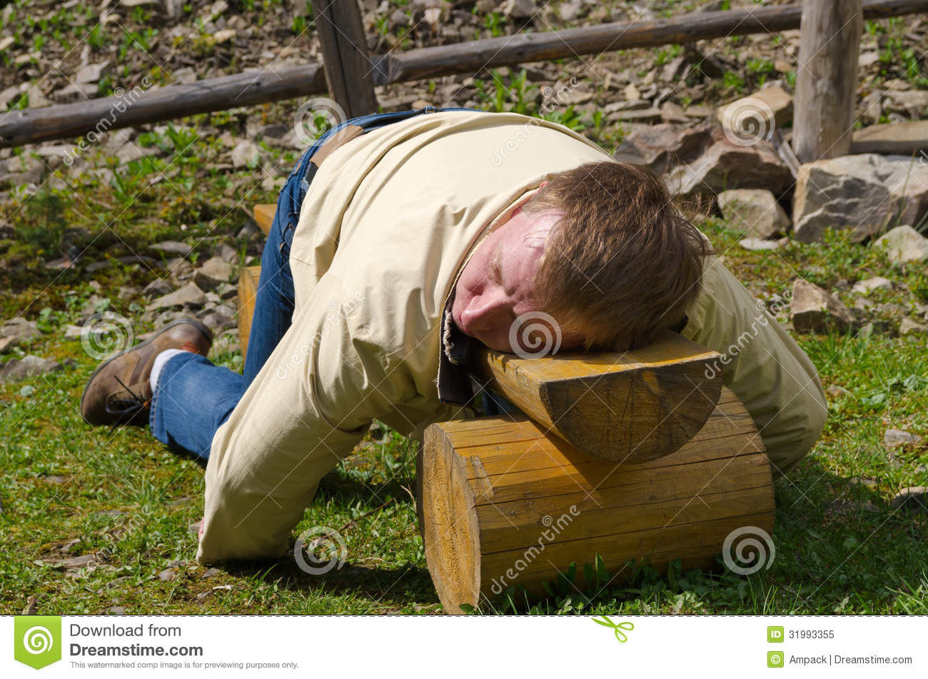 Man Sleeping On A Wooden Bench Royalty Free Stock Photo