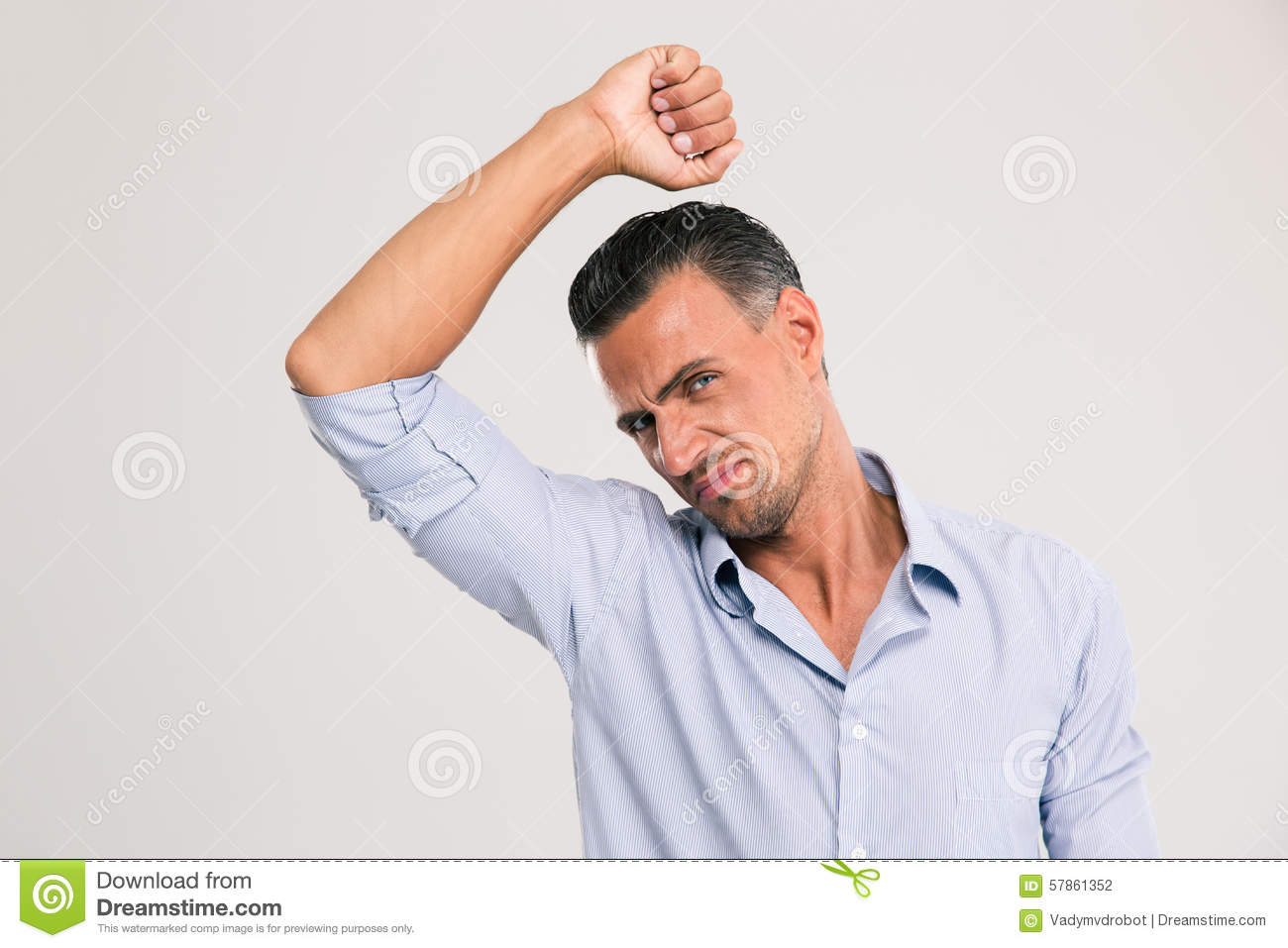 Man smelling sniffing his armpit