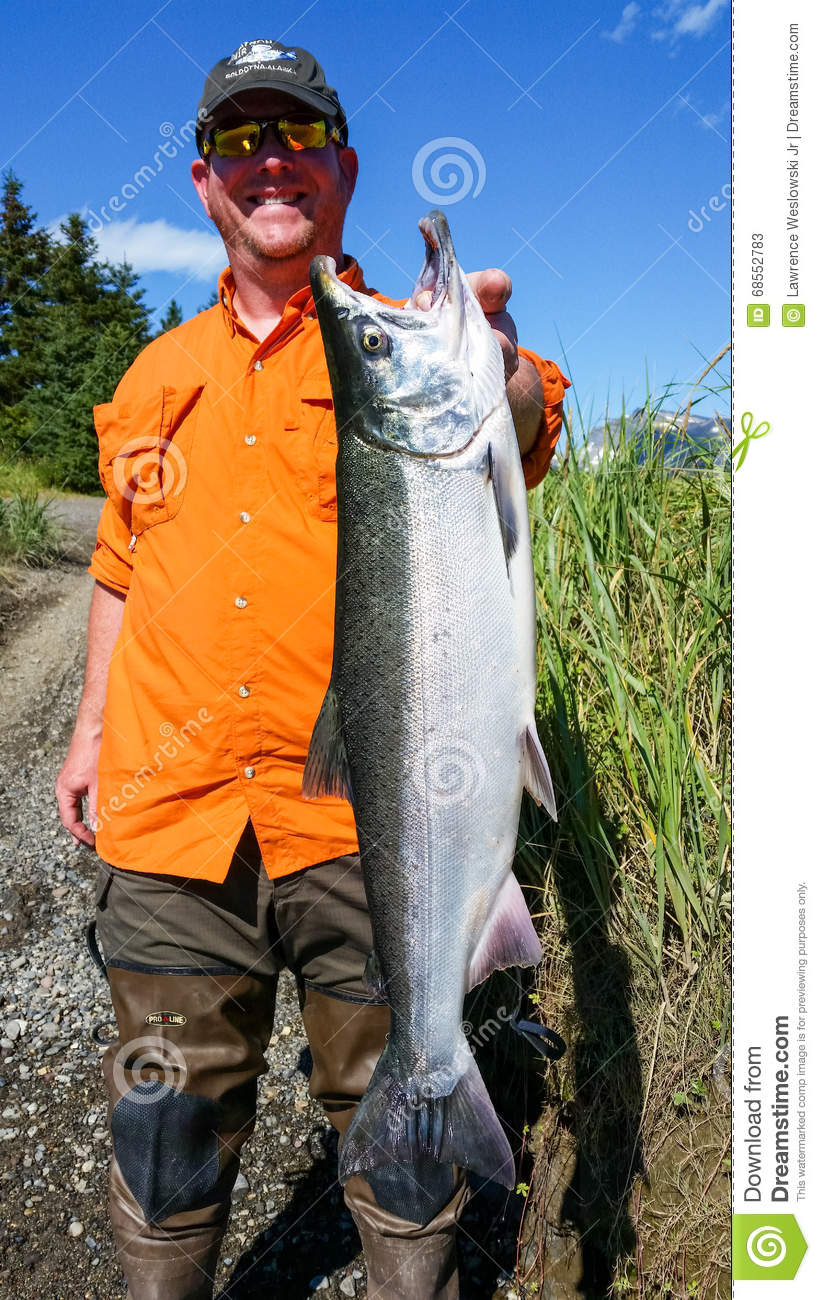 Alaska happy woman holding big halibut editorial photo for Best time to fish in alaska