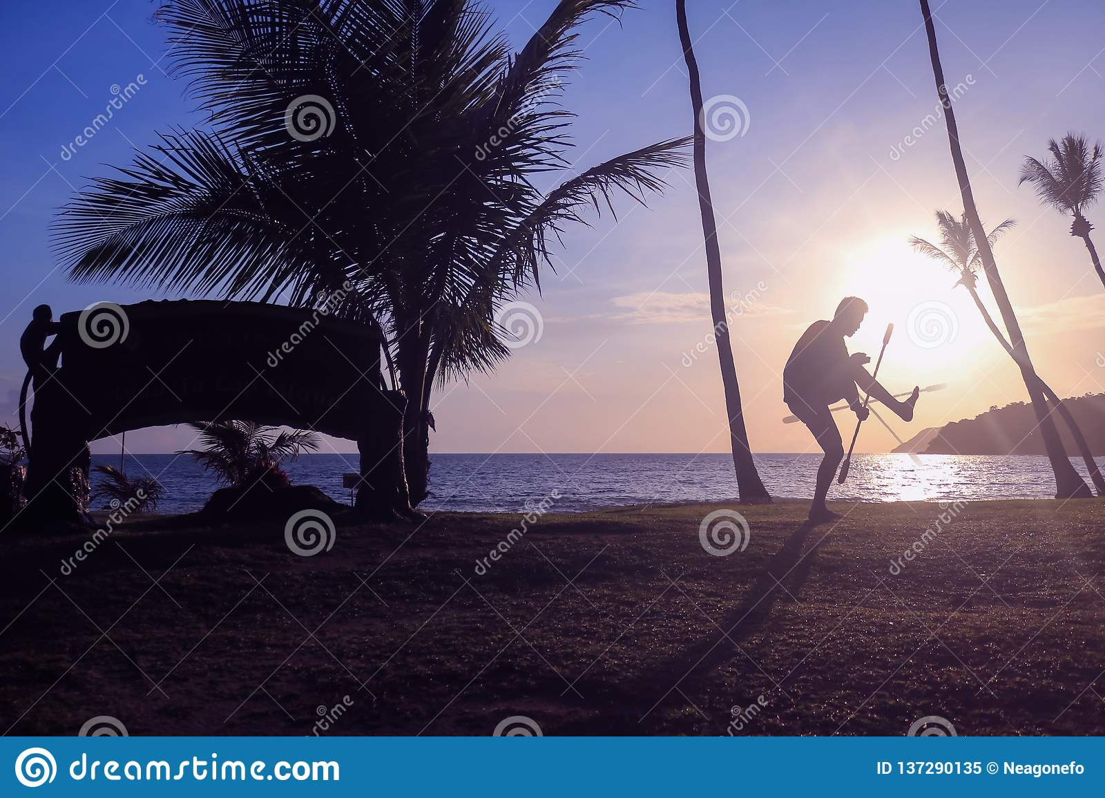 Man Spinning Contact Staff Or Stick On The Beach With Sunrise Stock