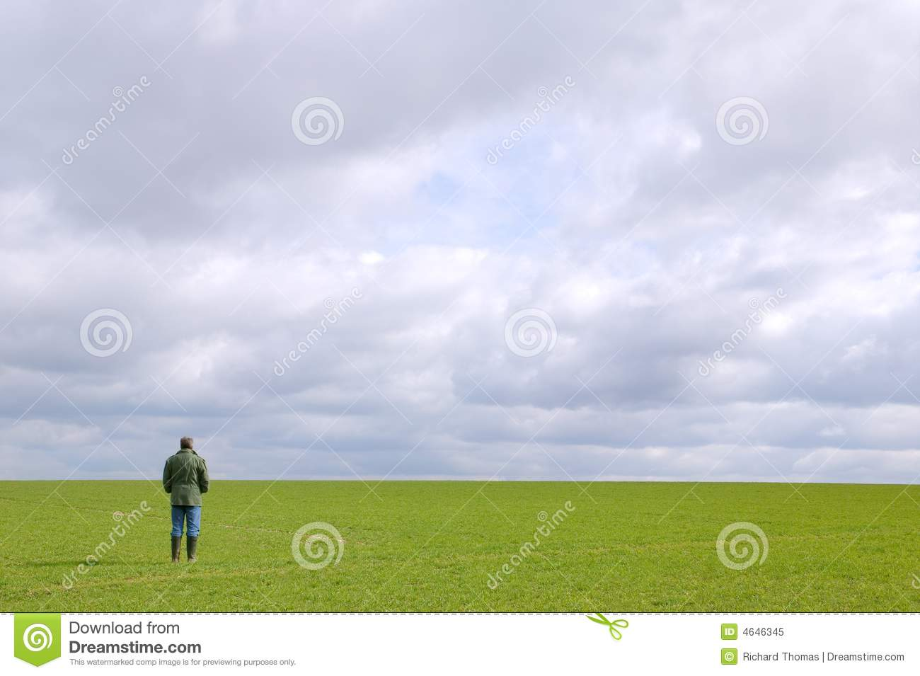 man standing alone in a field royalty free stock photo