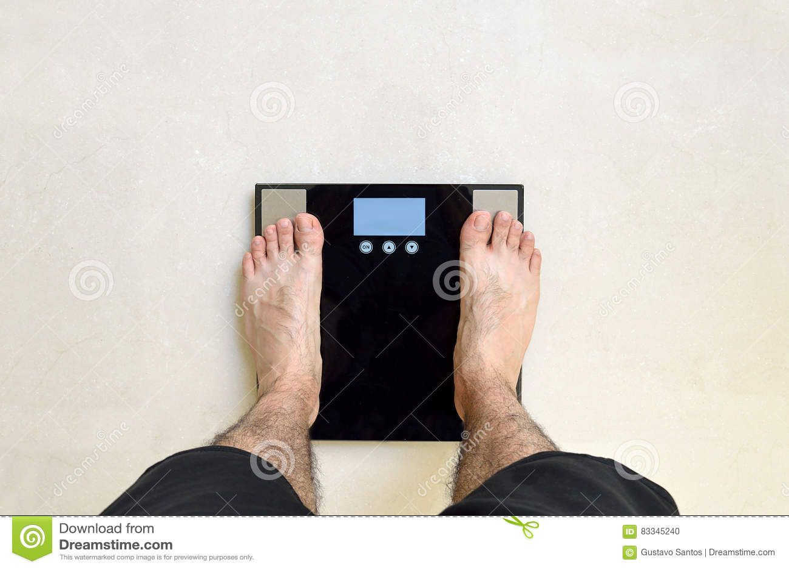 Black Bathroom Scales Man Standing On A Black Bathroom Scale Stock Photo Image 83345240