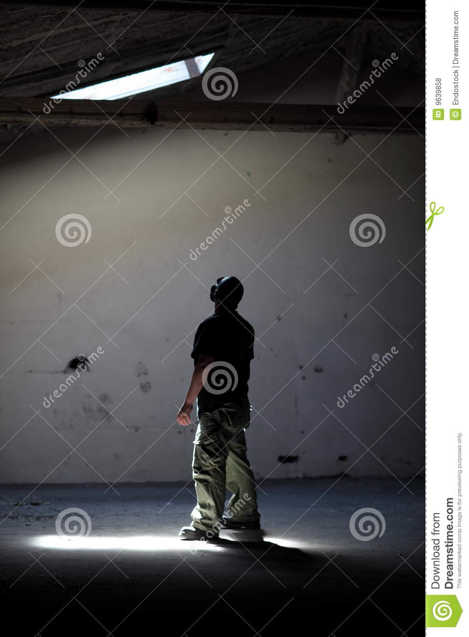 Man Standing In Light Stock Photo Image Of Ceiling