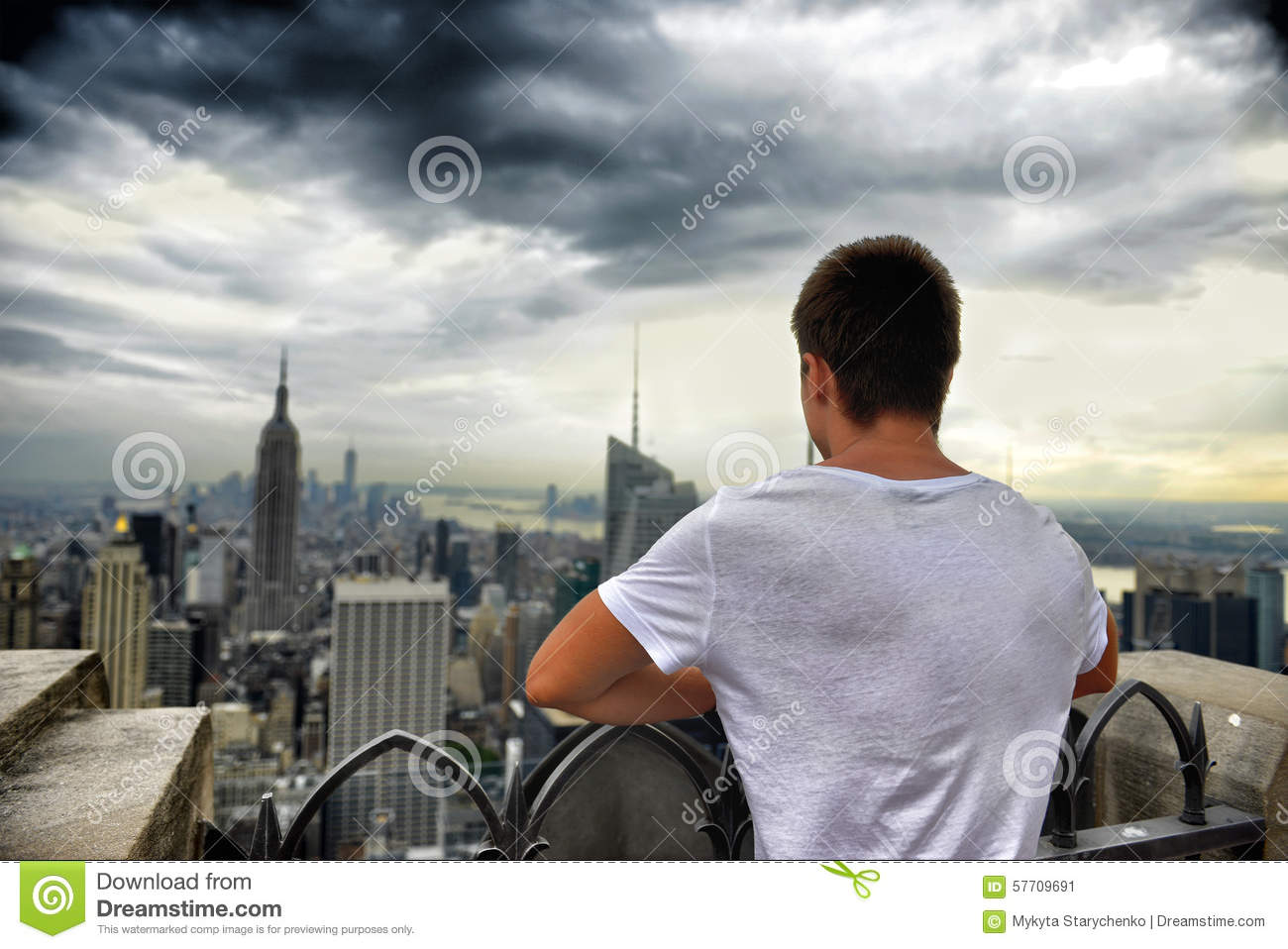 Man Standing On The Roof Top And Looking On New York Stock