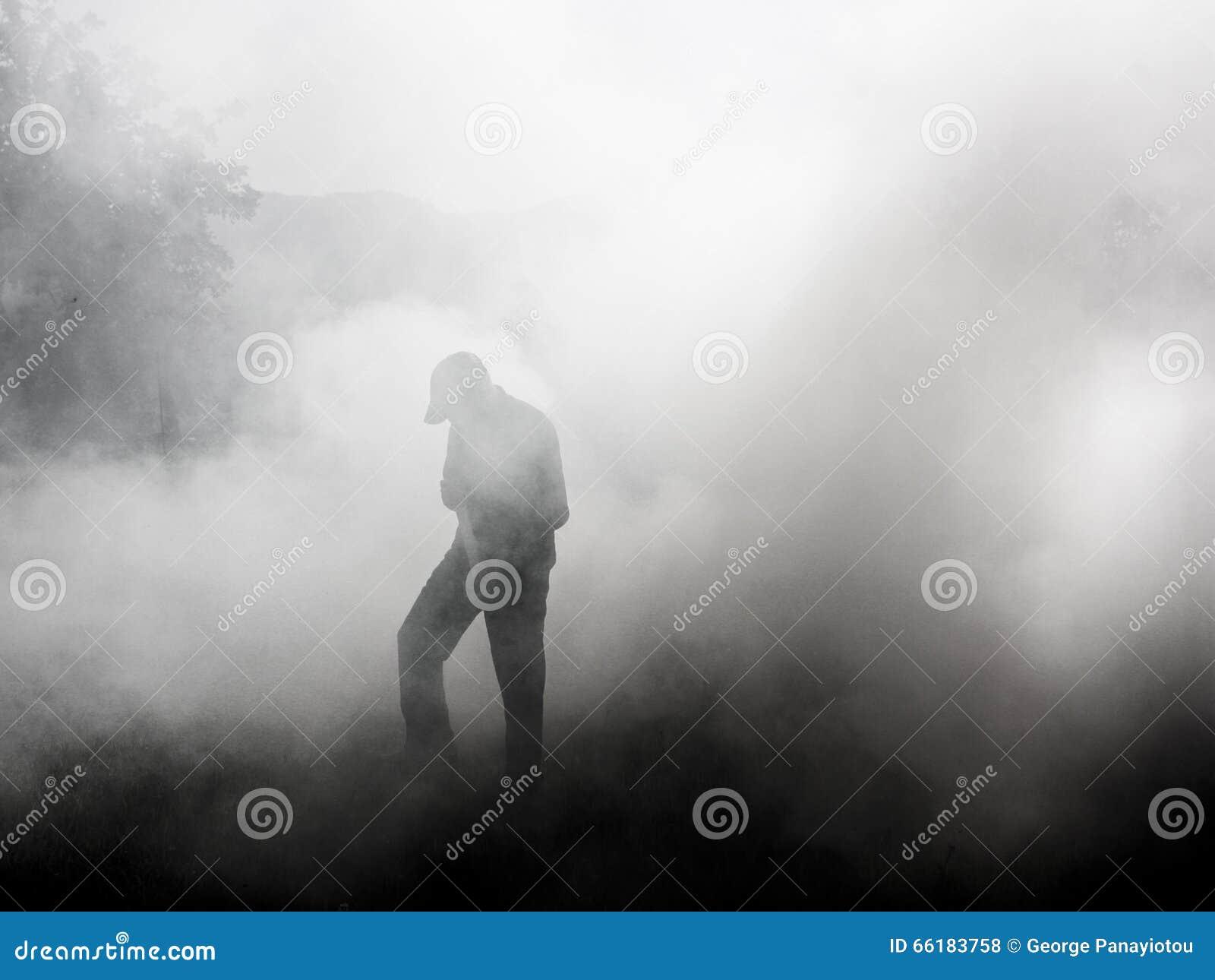 Man standing in smoke.