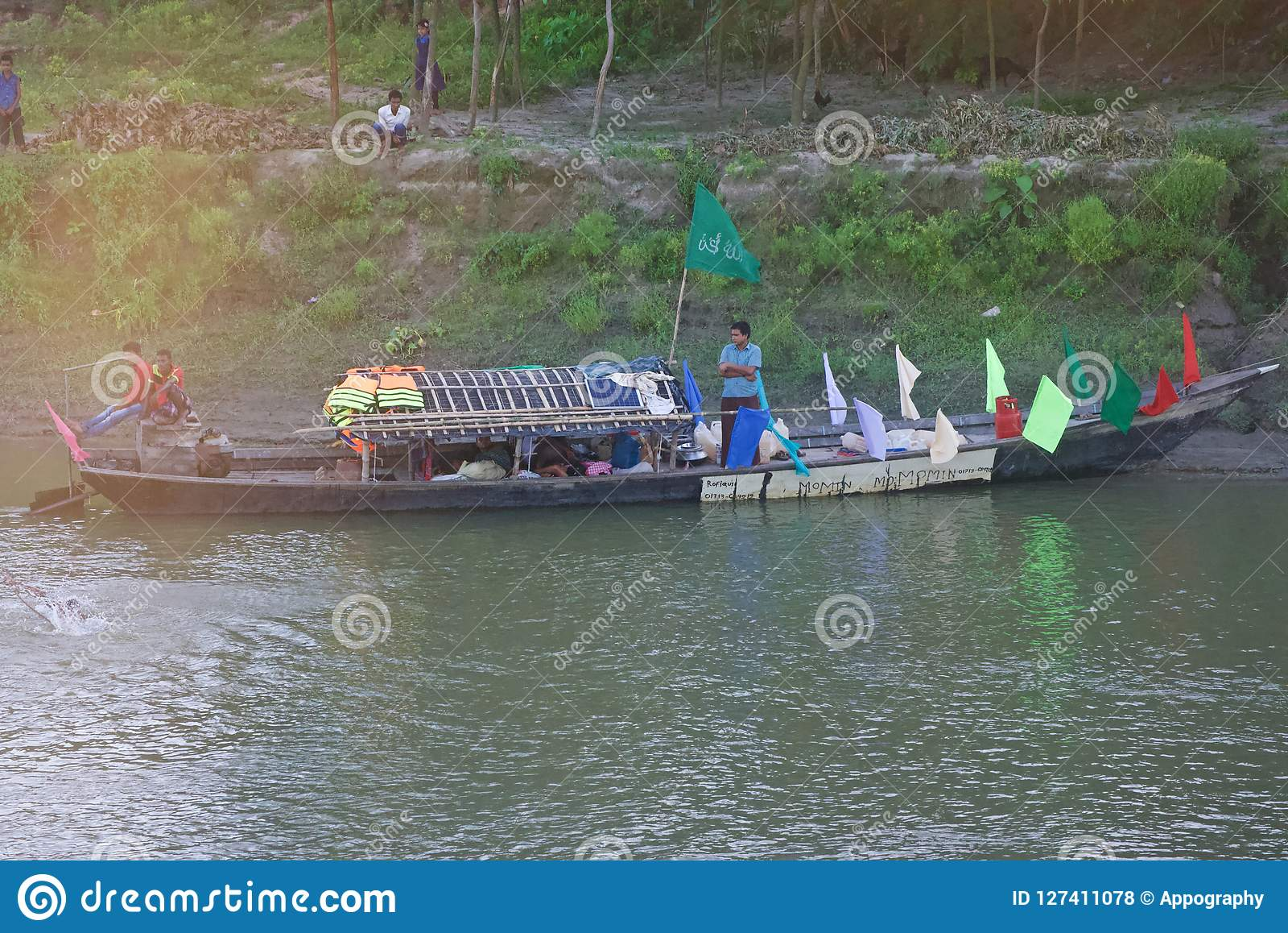 A Bangladeshi traditional boat in the river unique photo