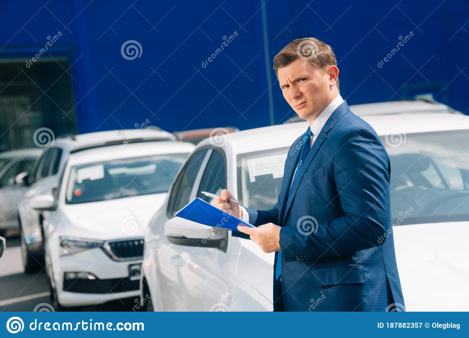 A Man Stands Near The Transport The Agent Holds The Car Keys And Tablet Next To The Car Stock Image Image Of Agency Crash 187882357