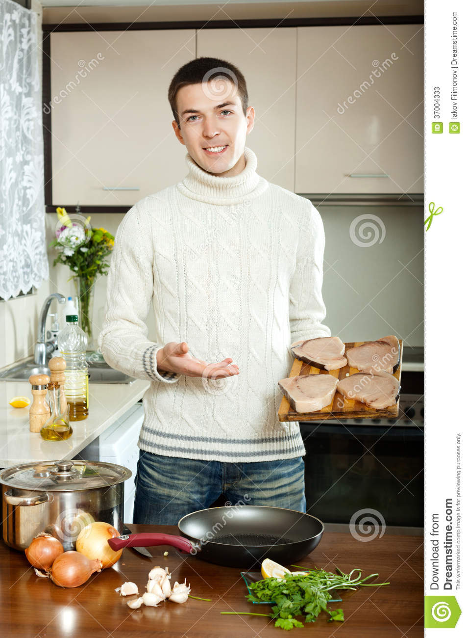 man with steak at home stock photos image 37004333. Black Bedroom Furniture Sets. Home Design Ideas