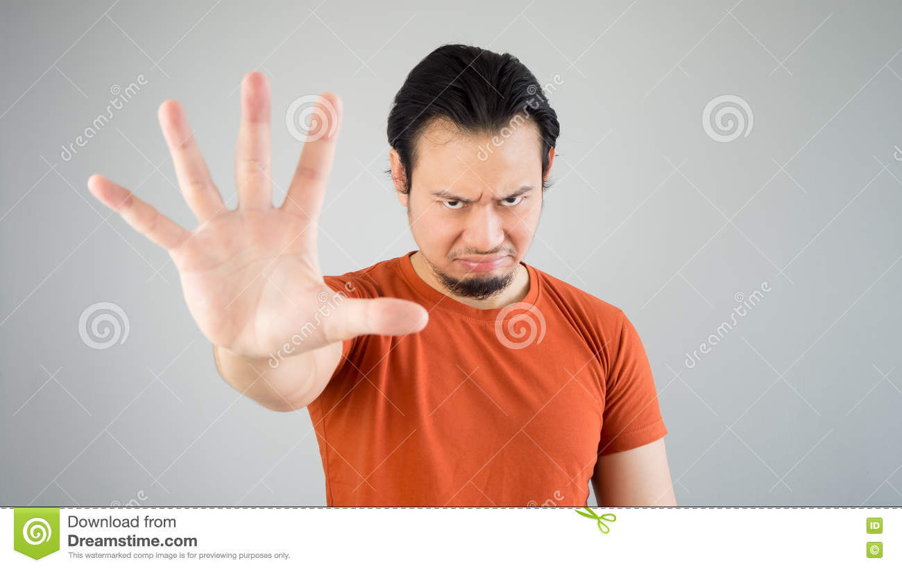 Man with stop hand sign. stock photo. Image of defense ...
