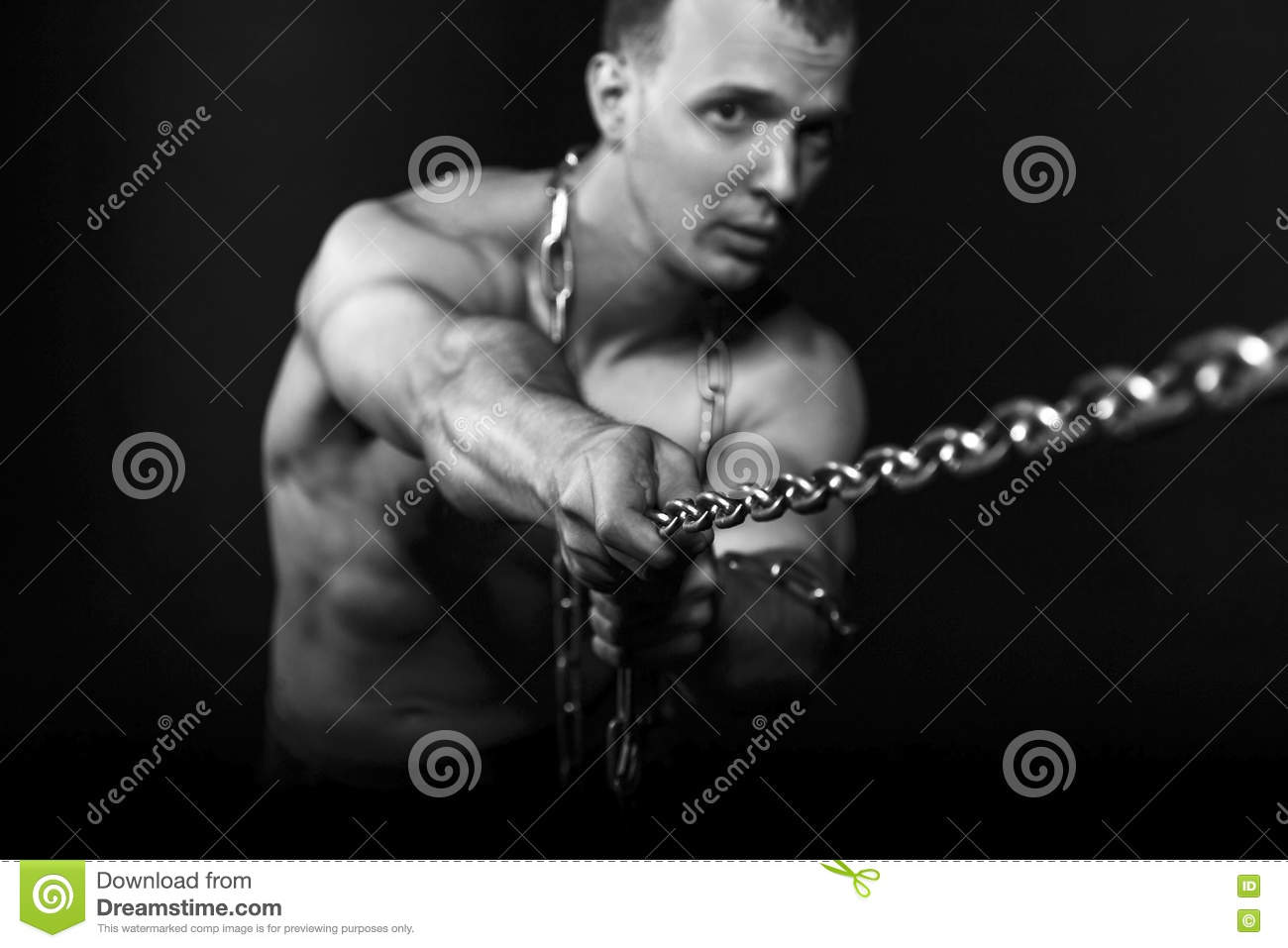 Man With Strong Muscular Arms Pulling The Chain Stock Photo Image