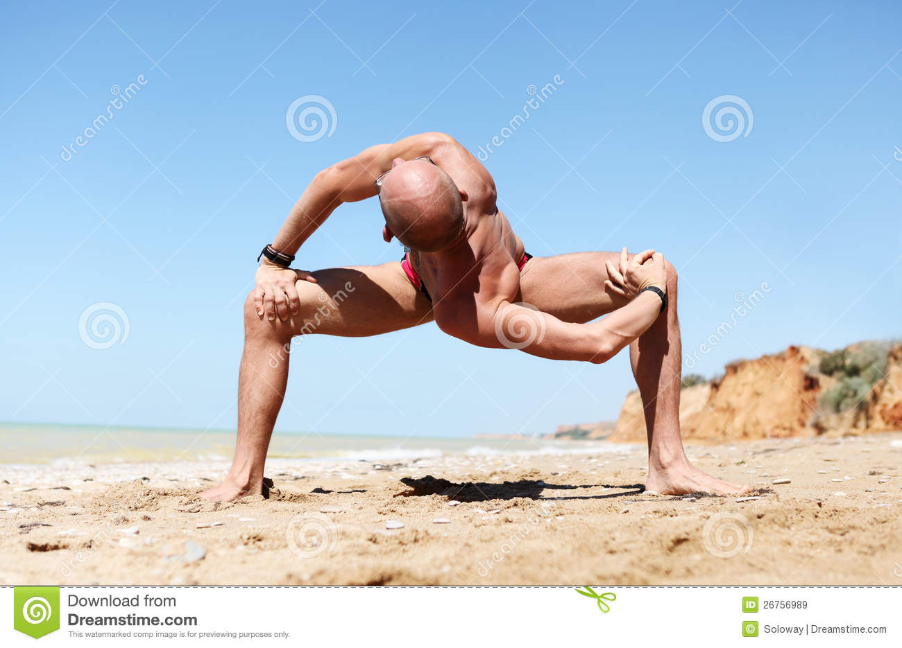 Download Man In Strong Spinal Twist Yoga Pose Stock Image