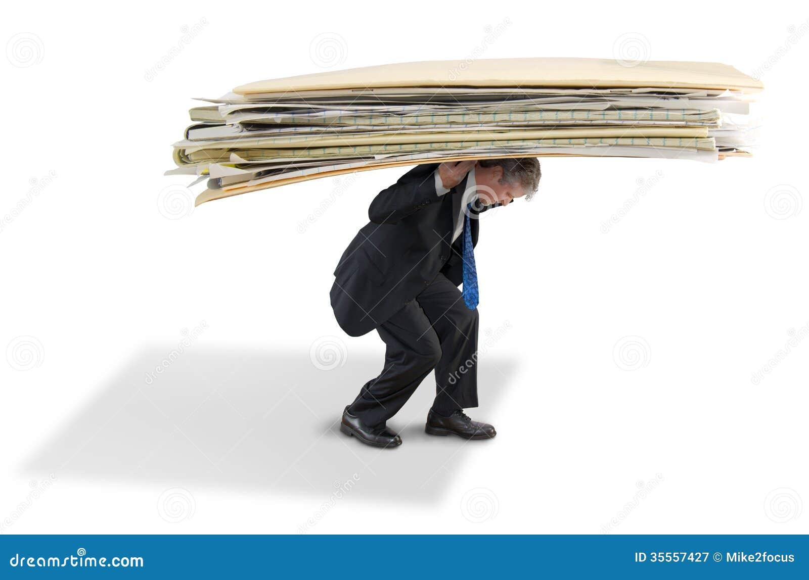 Man struggling under big pile of paperwork