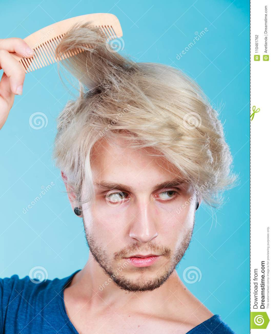 Man With Stylish Haircut Combing His Hair Stock Photo