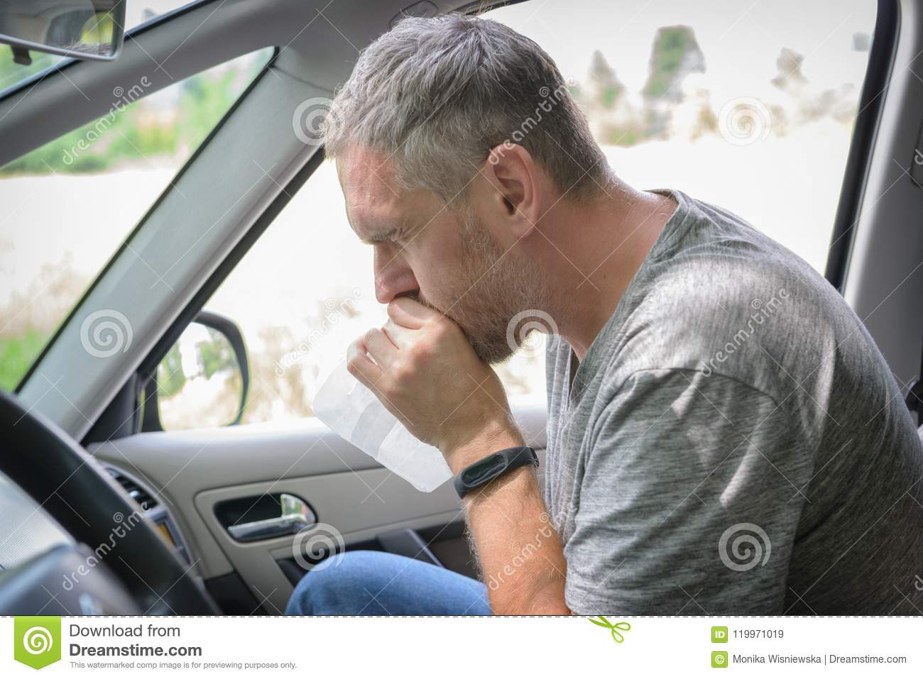 Man suffering from motion sickness