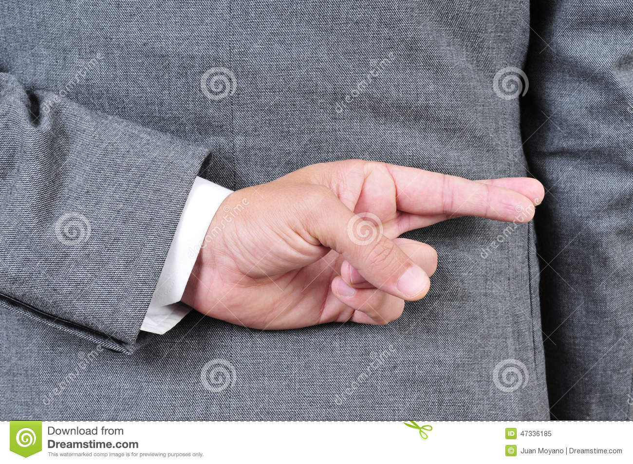 Man in suit crossing his fingers in his back