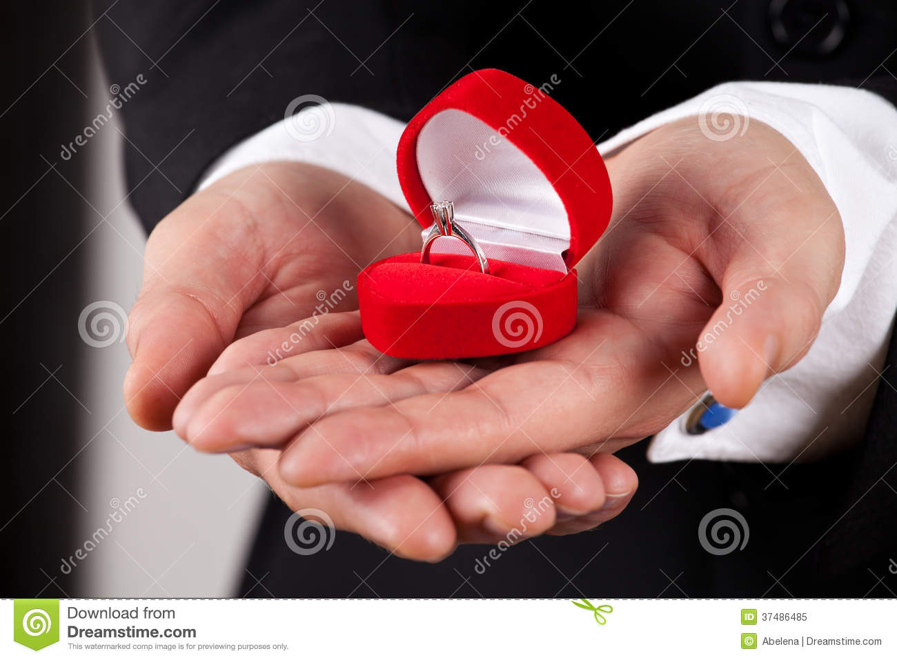 Man In Suit Holding Engagement Ring Stock Image - Image of opening ...