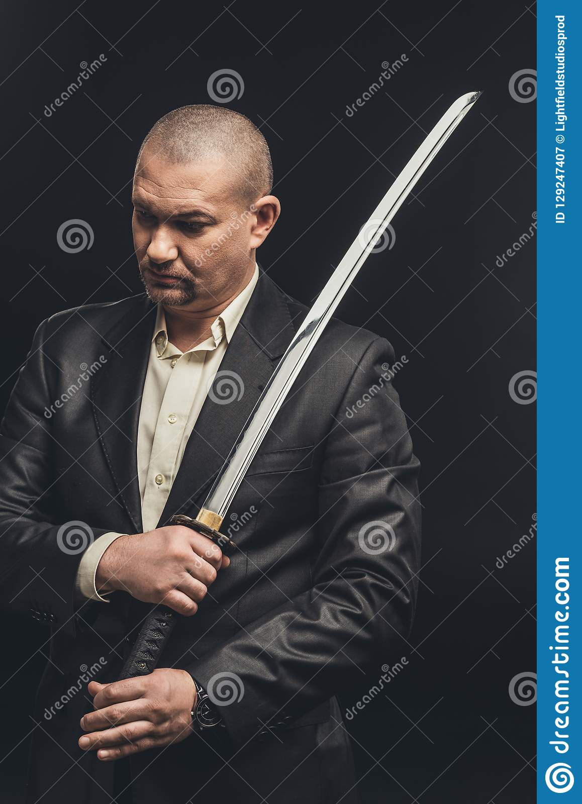 man in suit with katana sword