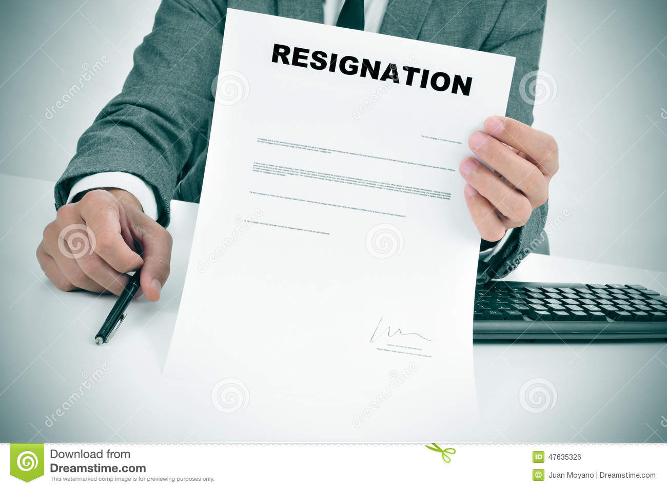 Man in suit showing a figured signed resignation document