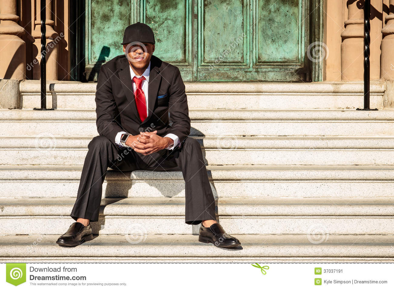Man In Suit Sitting On Steps Stock Image