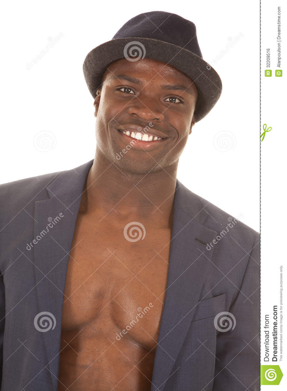 Man in suitcoat no shirt smile