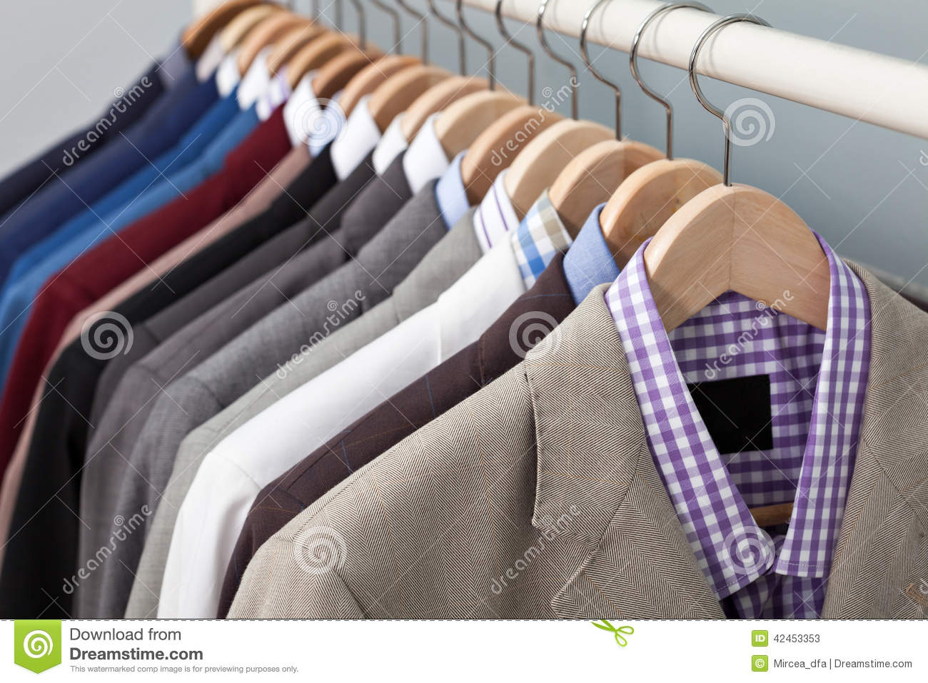 Man suits in a closet