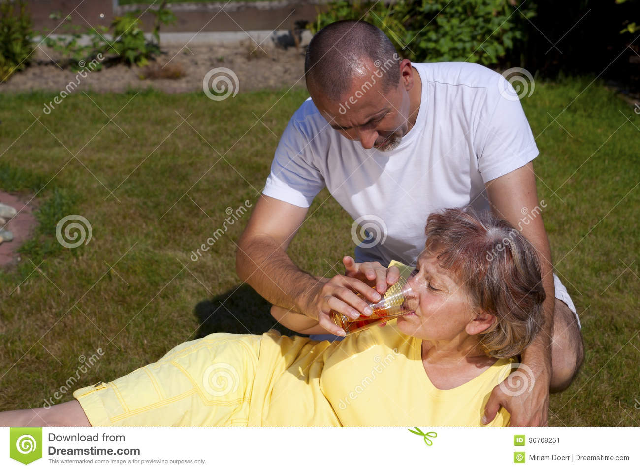 Man Supplied Woman With Heat Stroke Stock Image - Image ...