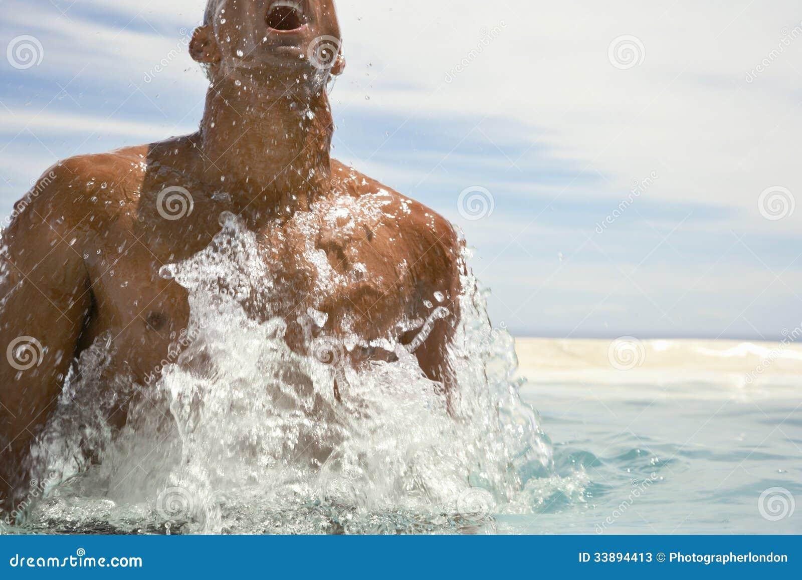 Man Surfacing In Swimming Pool Stock Image Of
