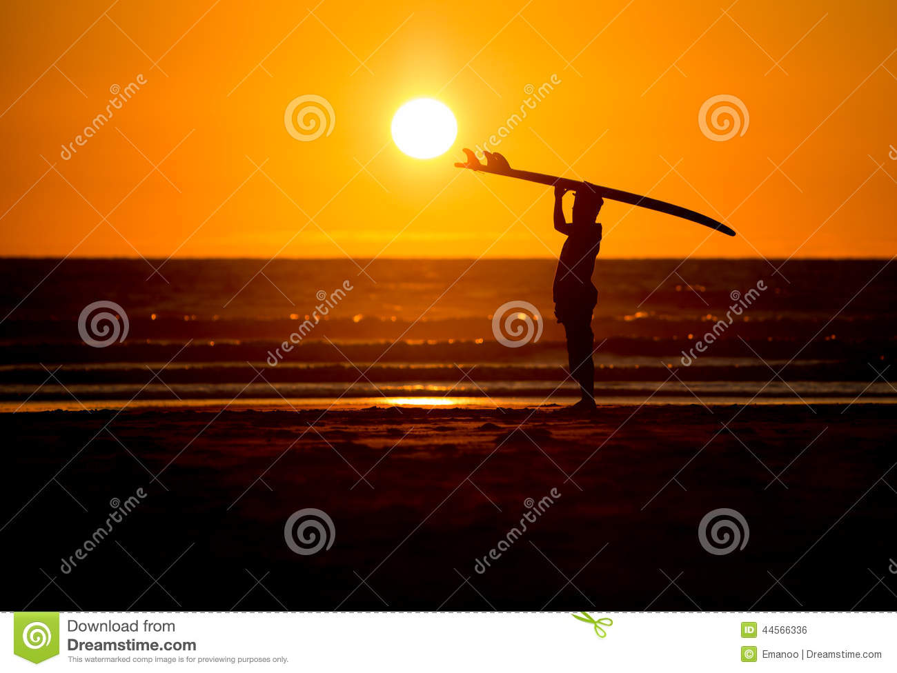 Man with surfboard in sunset at beach