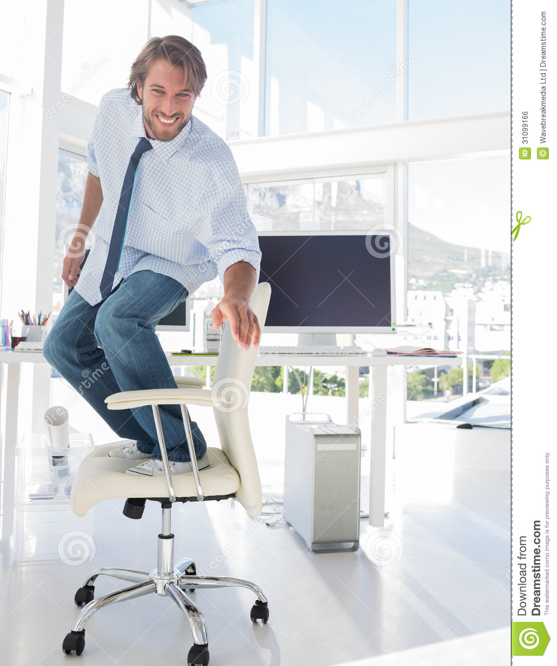 Man Surfing His Office Chair Royalty Free Stock Image