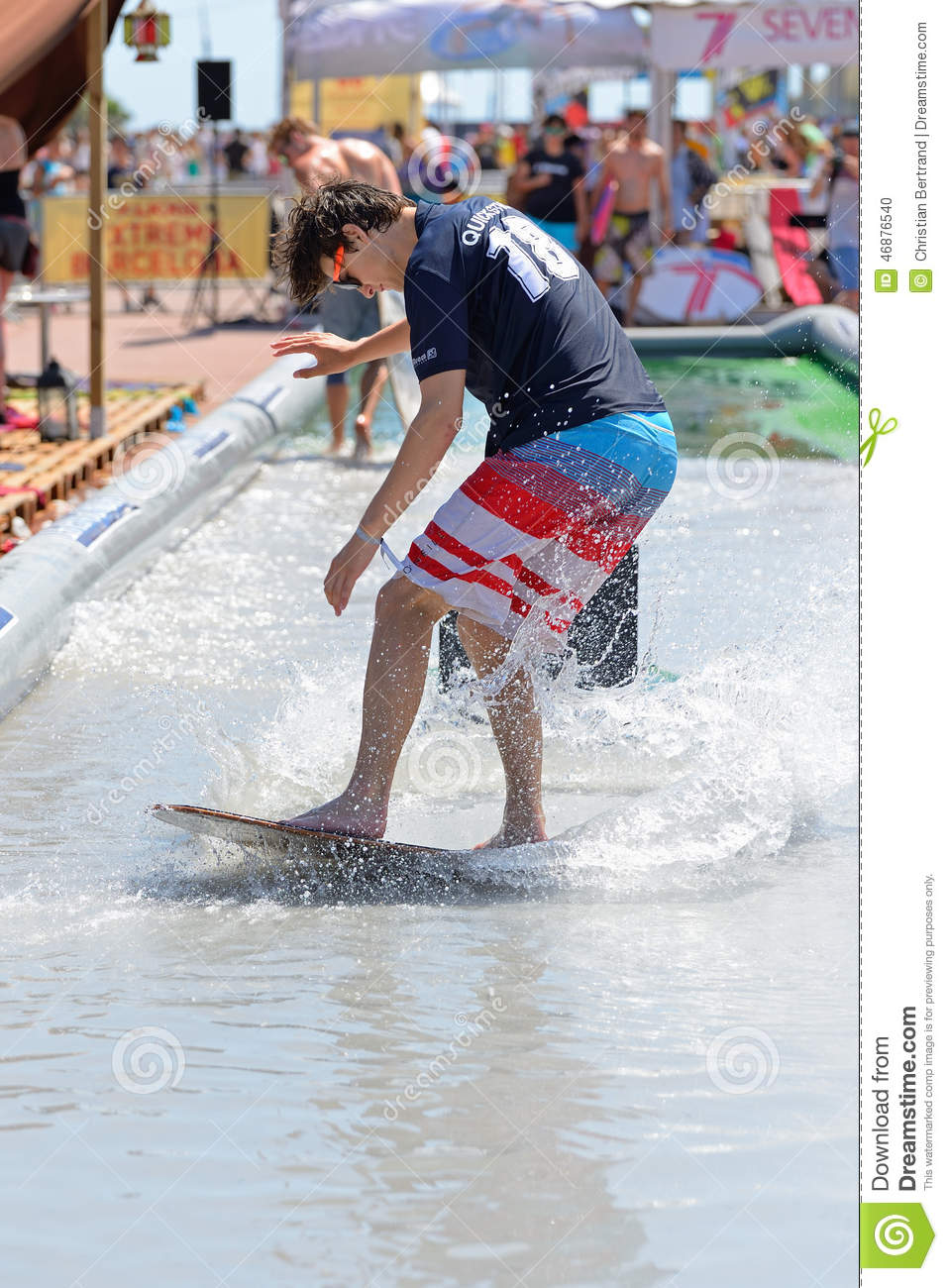A man surfing in a pool at LKXA Extreme Sports Barcelona Games