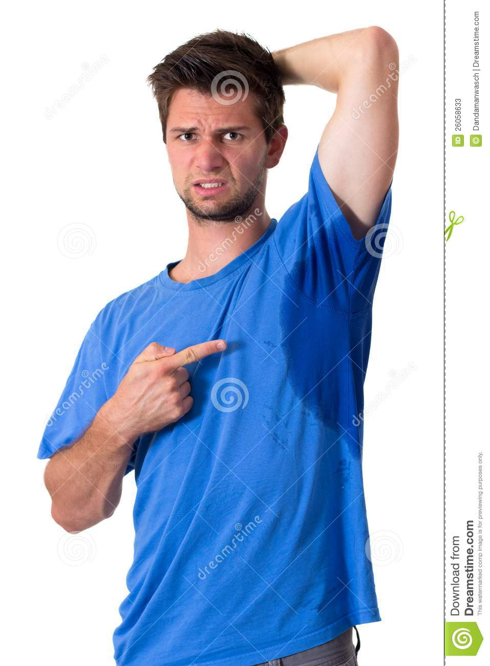 Man sweating very badly under armpit stock photos image for How to keep your armpits from sweating through your shirt