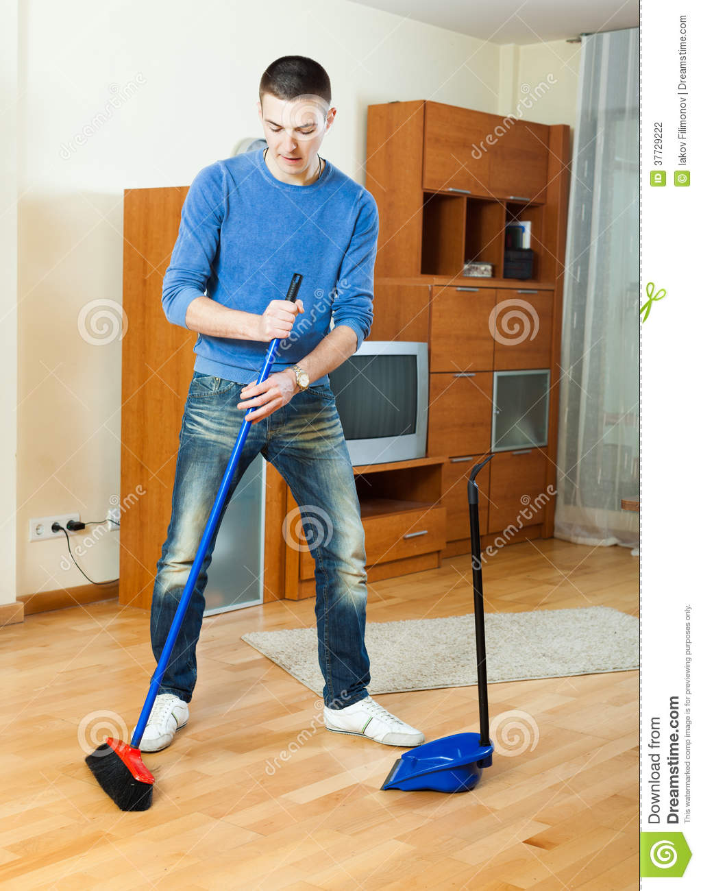 Man Sweeping The Floor At Home Stock Photography Image