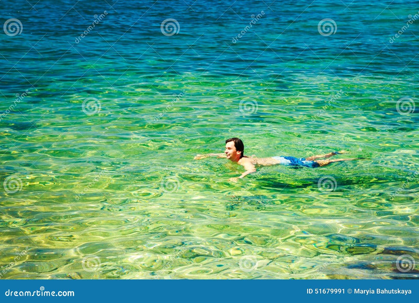 Man Swiming in Crystal Clear Sea