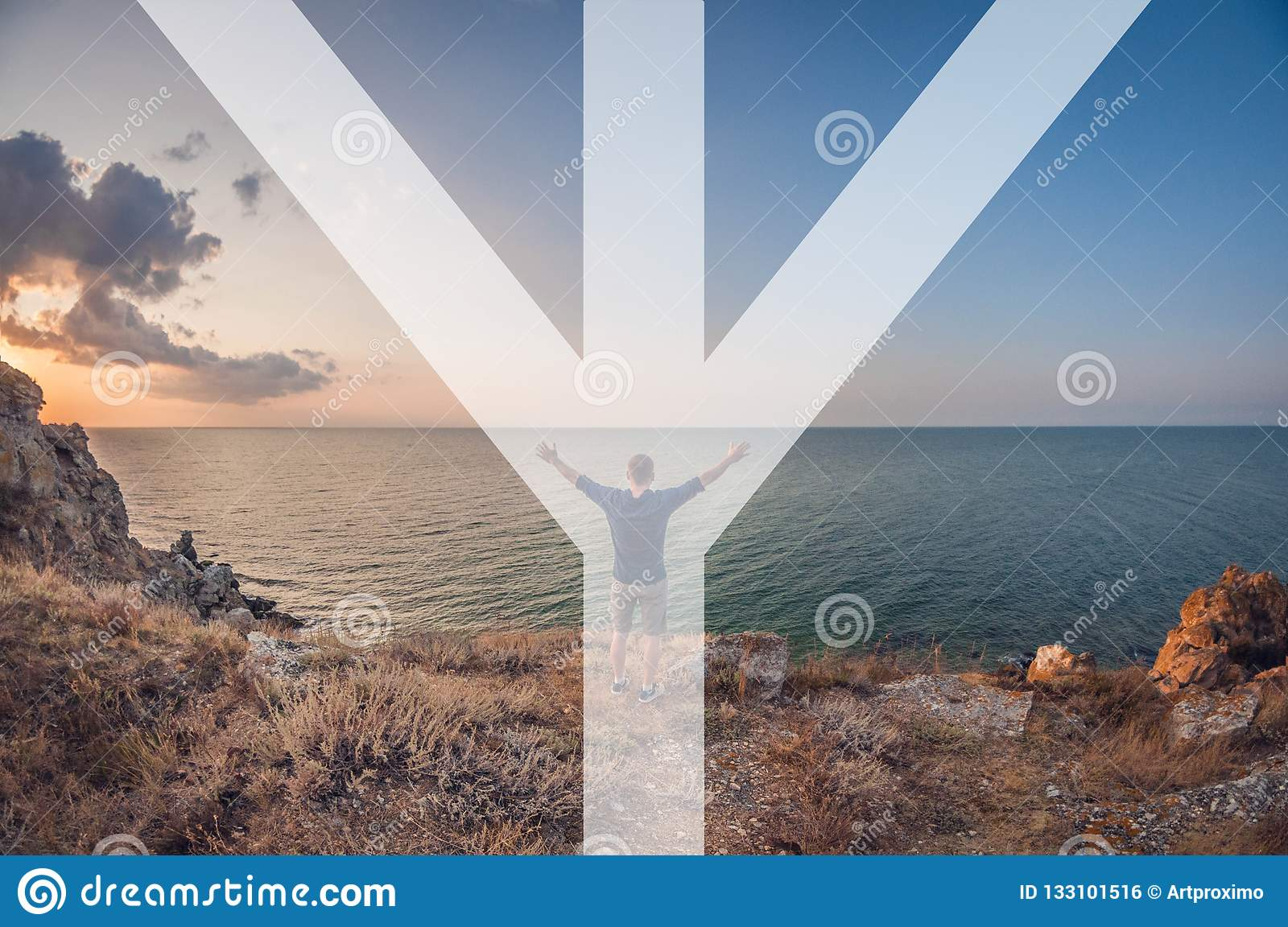 Man in nature, symbolizing the rune algiz man stands on the mountain raising his hands up and greets the rising sun