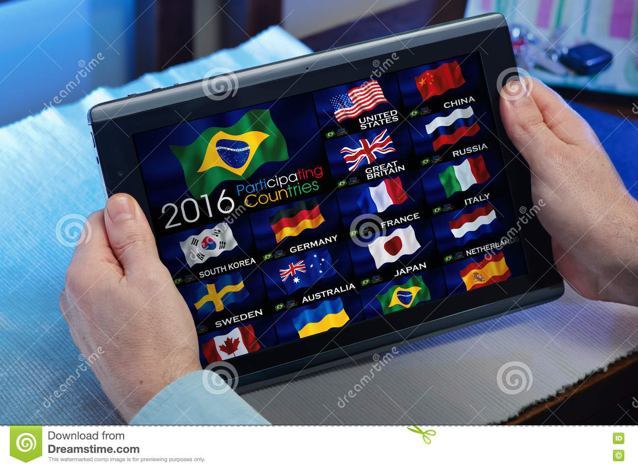 Man On Tablet Watching A Channel Of Olympics Sports On TV