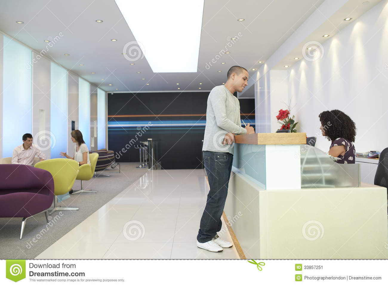 Man talking to receptionist at office stock image image 33857251