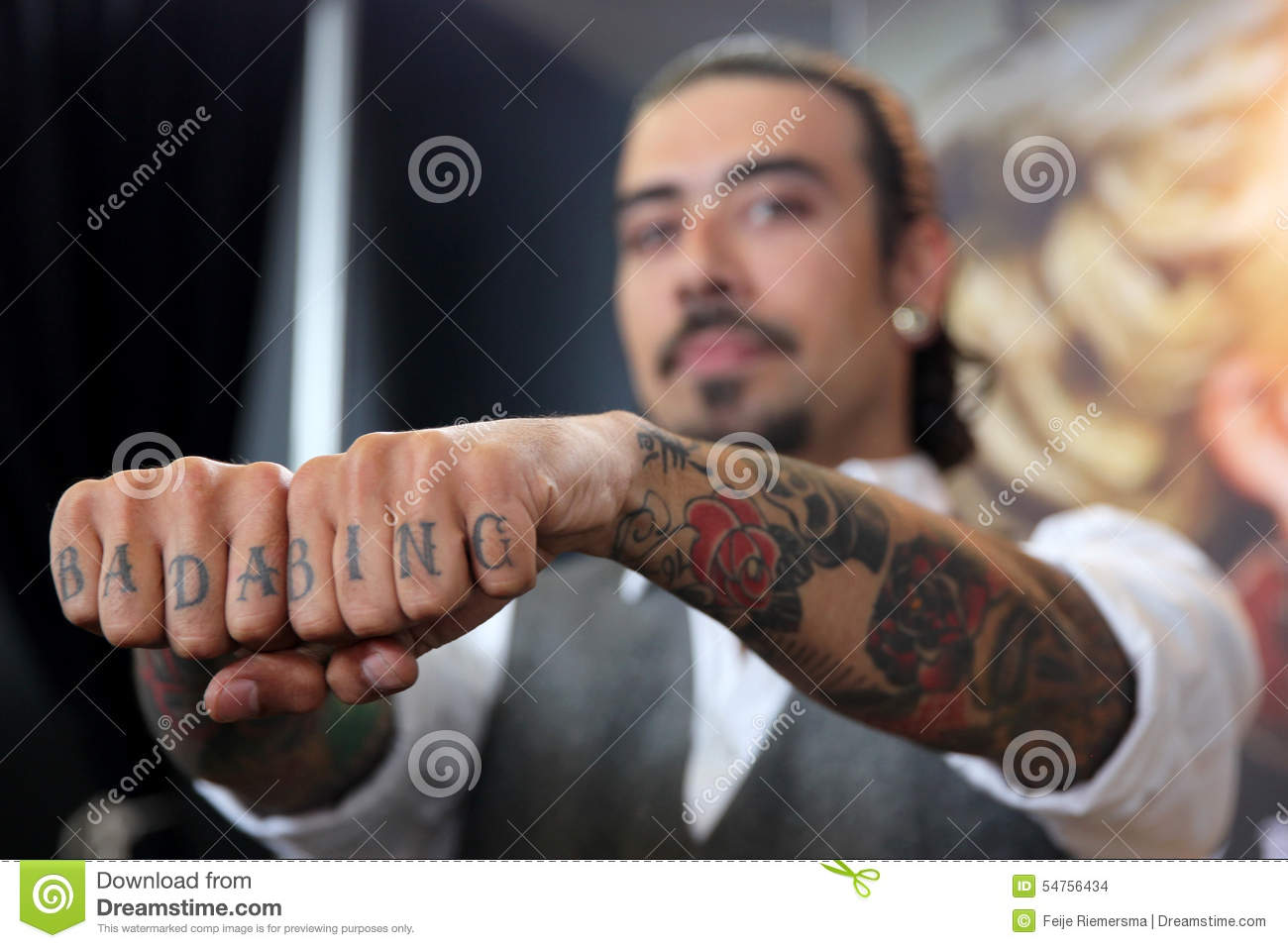 Man with tattoo on fingers editorial stock image. Image of ...