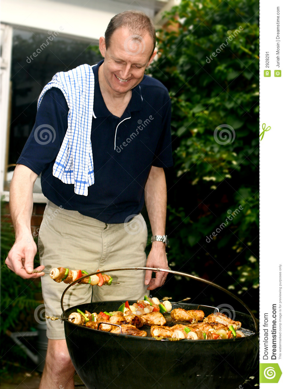 Man tending barbecue