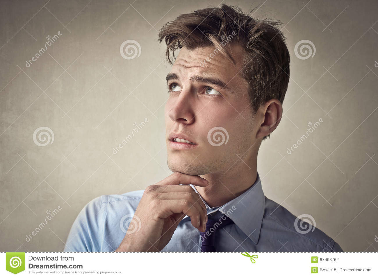 Man thinking with his hand on his chin