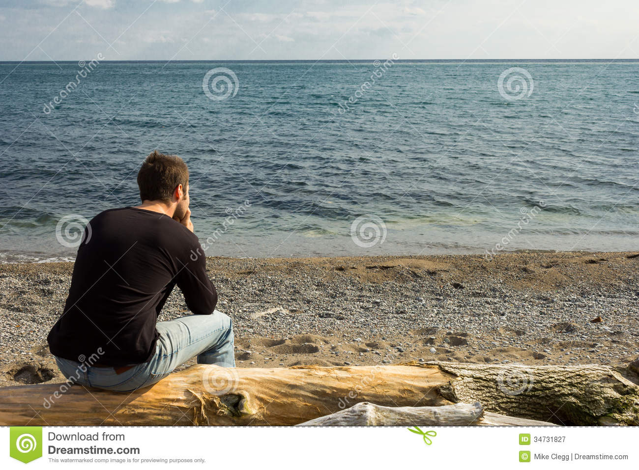 Extended Rear Facing >> Man thinking on a log stock image. Image of looking ...