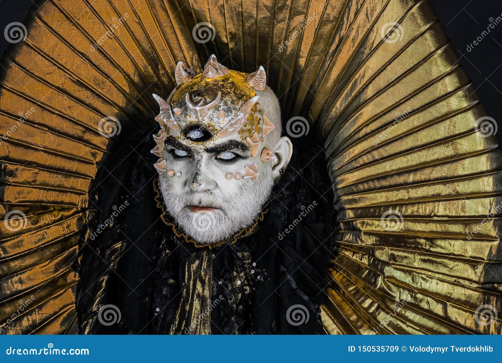 Man with third eye, thorns or warts. Senior man with white beard dressed like monster. Alien, demon, sorcerer makeup