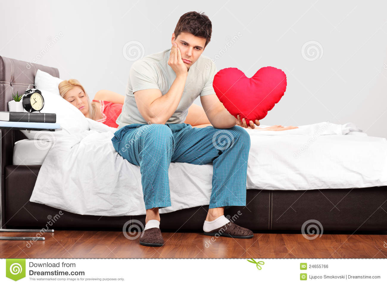 Man Shaped Pillow Man In Thoughts Holding A Heart Shaped Pillow Royalty Free Stock