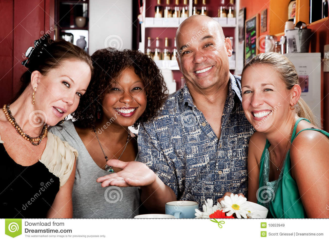 Man with three pretty women in coffee house