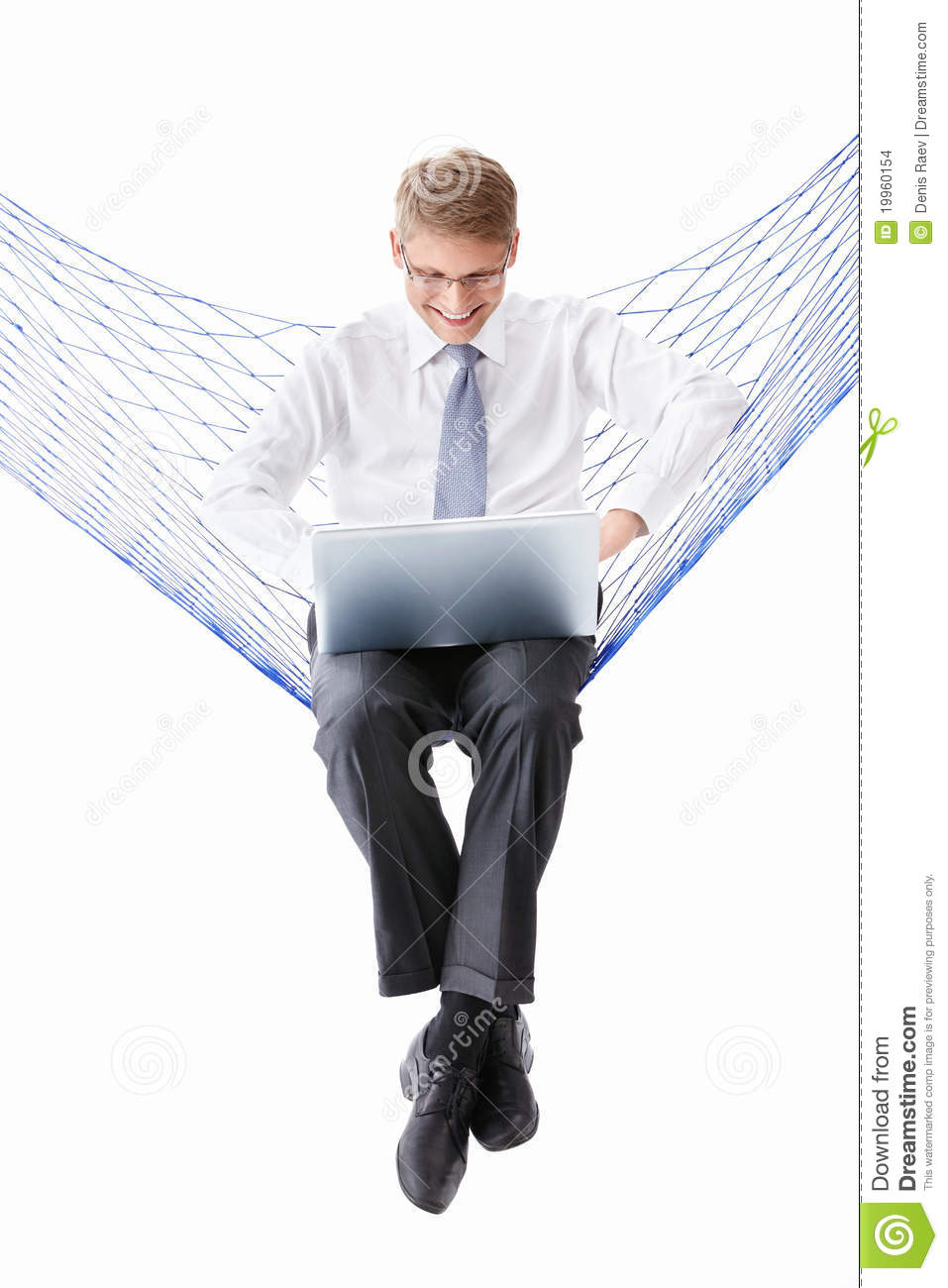 A man in a tie with a laptop