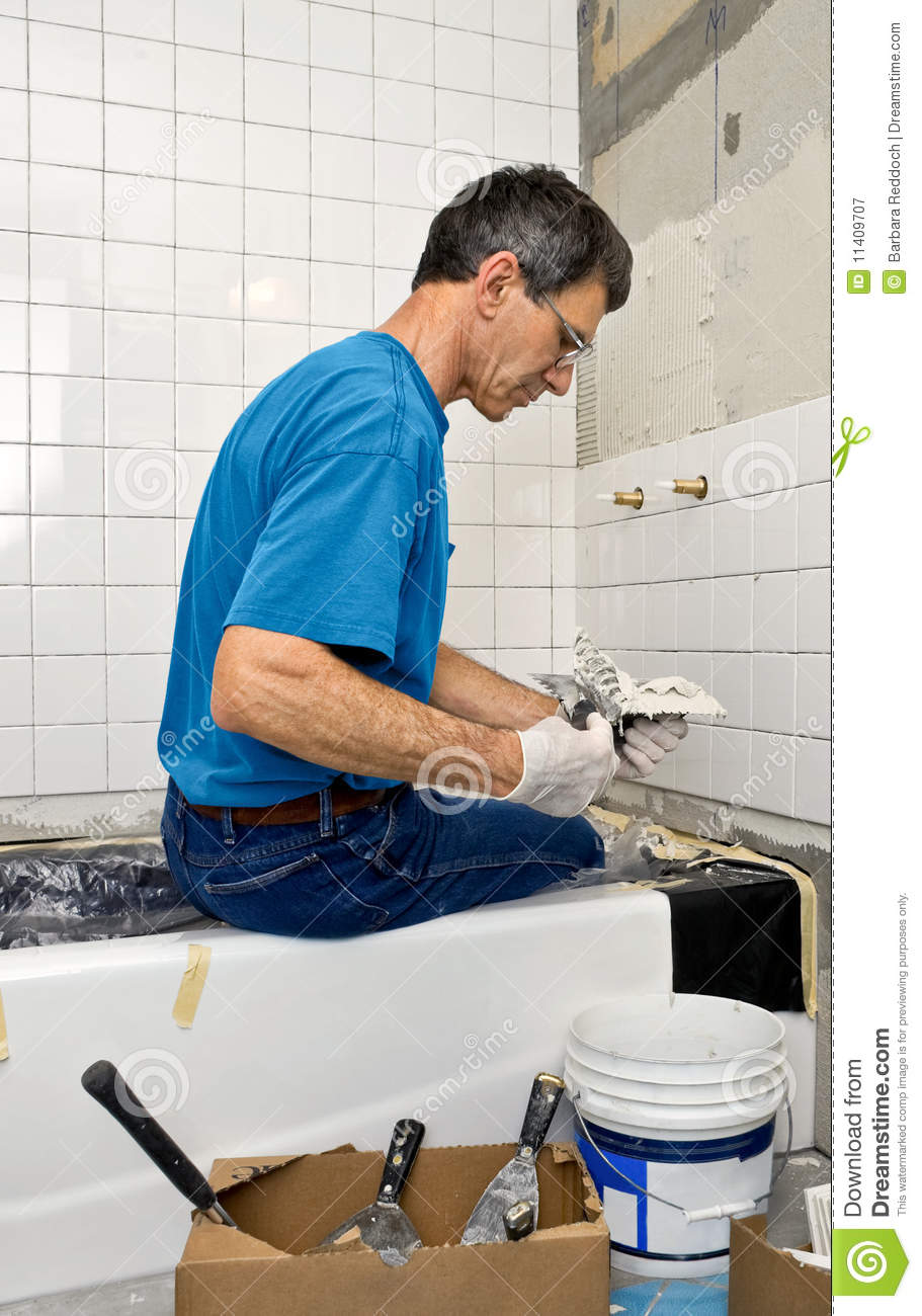 Man Tiling A Bathroom Wall stock image. Image of sheetrock - 11409707