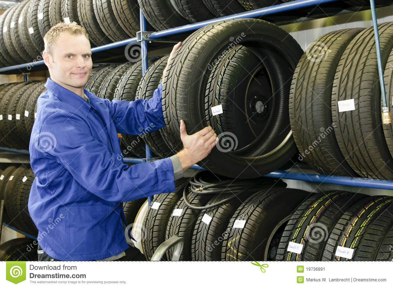 Man In The Tire Store With A Tire Stock Image Image